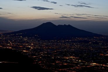 Vesuvius in the night lights of Naples
